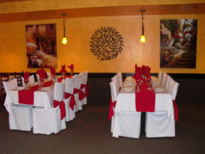 Tables set with decorative cloths and napkins