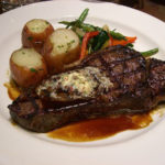 Steak and Potatoes with Au Jus and Vegetables